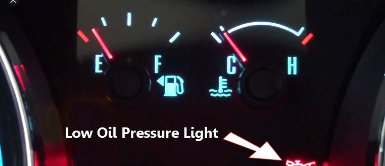 What causes low oil pressure on diesel engine